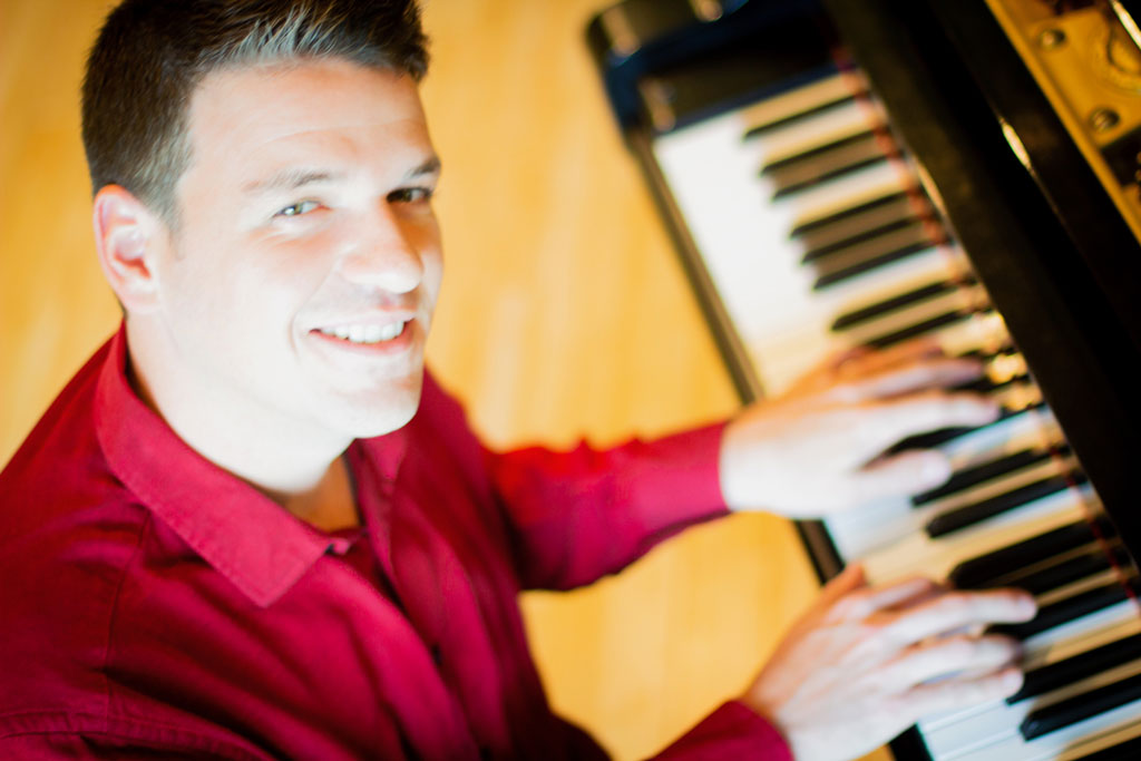 Brady Goss Headshot Piano Keys Big Red Barn Studios